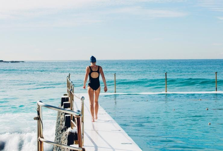 Woman out for a morning swim at Bondi Icebergs at Bondi Beach in New South Wales © Destination NSW/Issac Brown