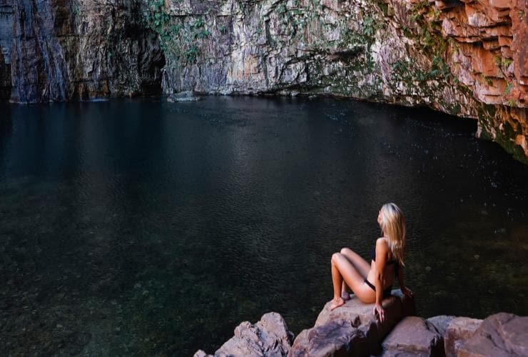 Woman sitting on rock at Emma Gorge © Tourism Australia