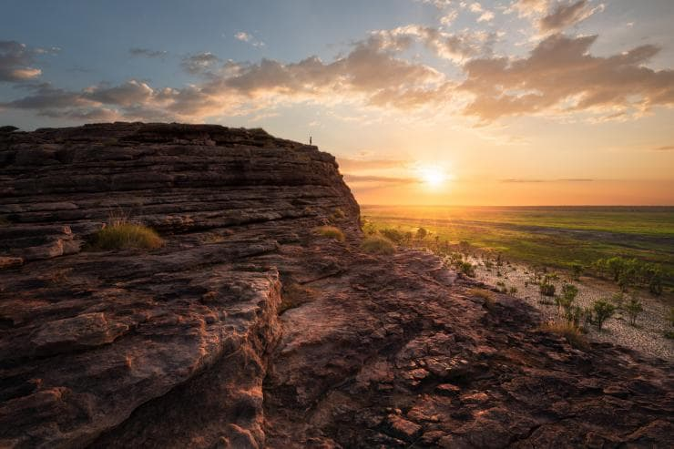 Man standing on the top of the rock in Ubirr, Kakadu National Park © Tourism NT/Daniel Tran9