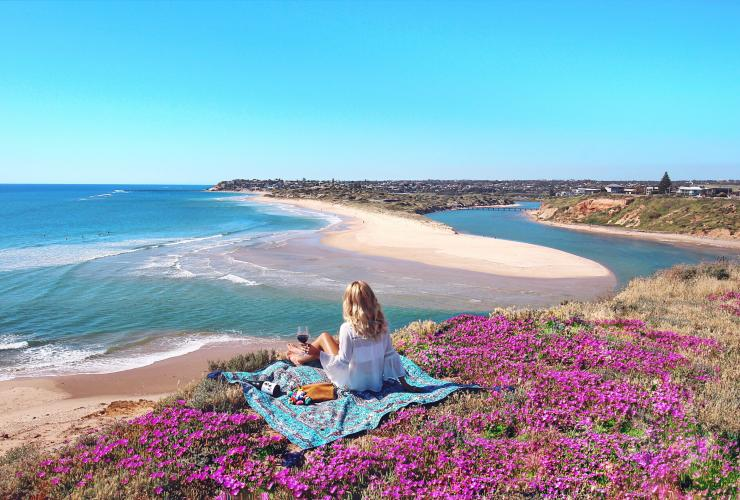 Young woman enjoys picnic among wildflowers on the Fleurieu Peninsula © Elise Cook