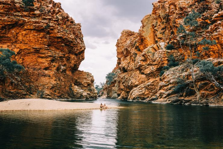Relaxing at Ellery Creek Big Hole, West MacDonnell Ranges, NT © Tourism NT, Laura Bell
