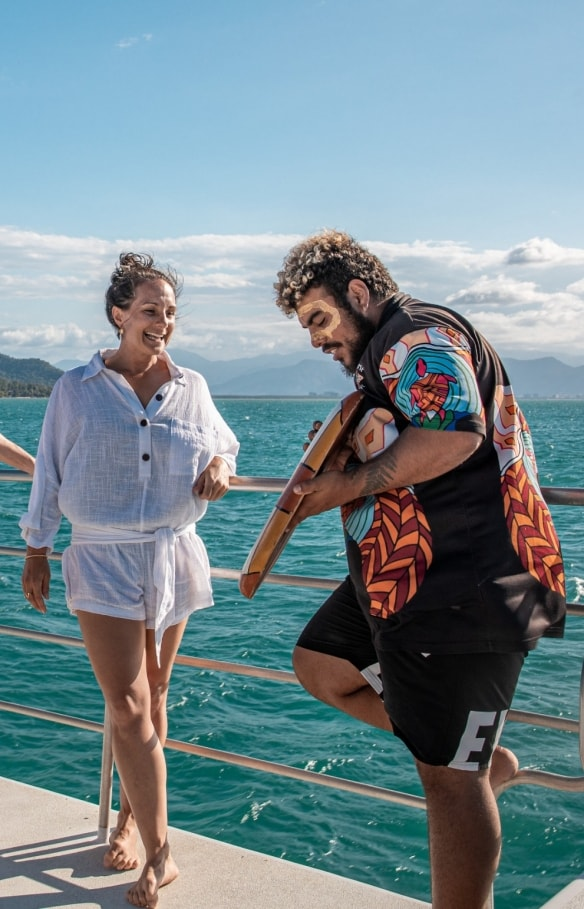 Visitors learning about Indigneous culture on board a Dreamtime Dive and Snorkel boat © Tourism and Events Queensland