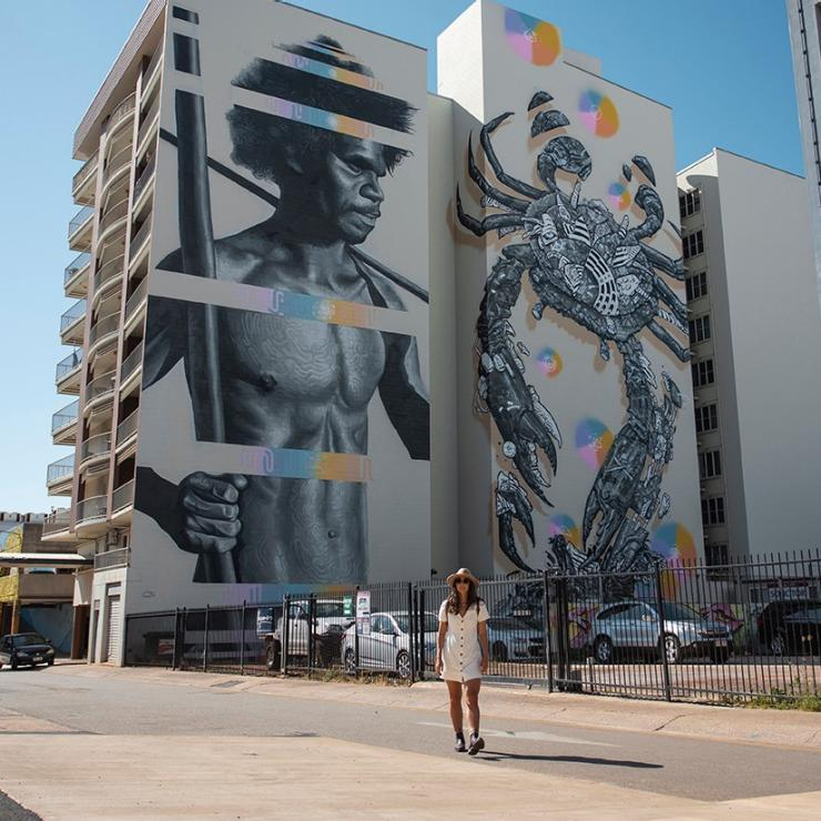 Woman standing in front of a mural in Darwin © Tourism Australia