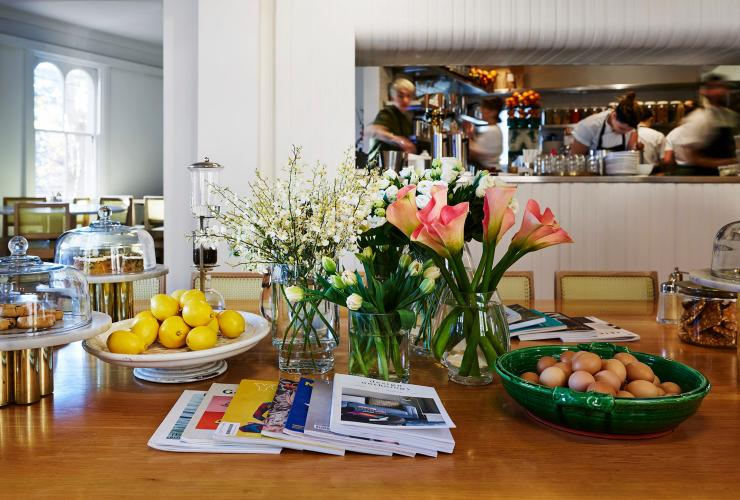 Table with flowers and magazines at Bills, Darlinghurst, Sydney, New South Wales © Megann Evans Photography