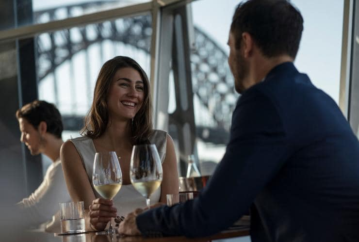 Couple enjoying food and drink at Quay Restaurant © Destination NSW/Dick Sweeney