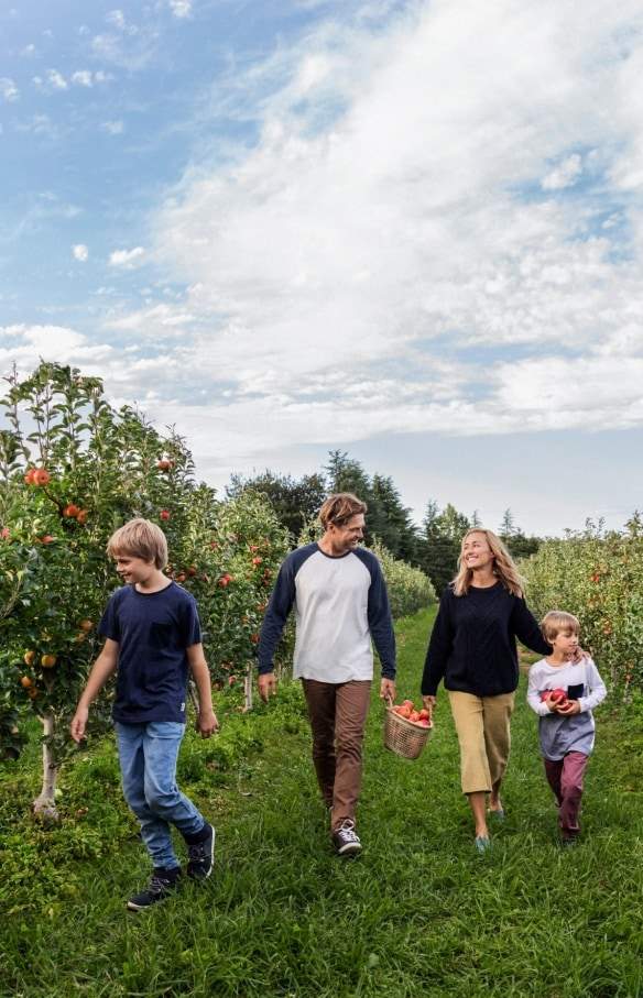 Family enjoying a day of apple picking at Shields Orchard in Bilpin  © Destination NSW