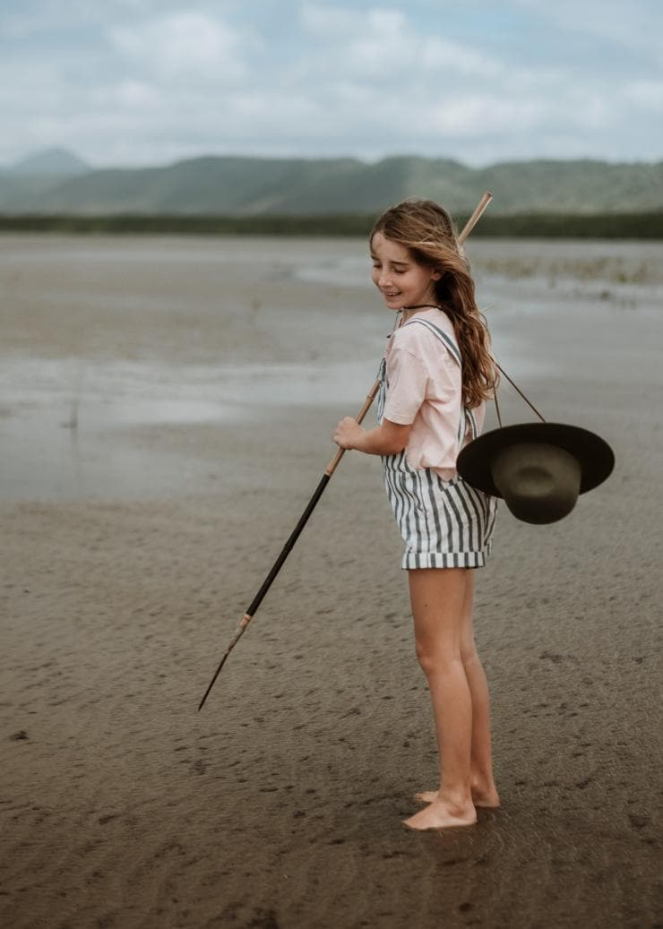 Child learning to spearfish on Cooya Beach near Cairns © Tourism and Events Queensland