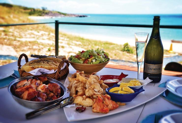 A meal served on a table next to the ocean at Banubanu Wilderness Retreat © Oliver Thompson/Banubanu Wilderness Retreat