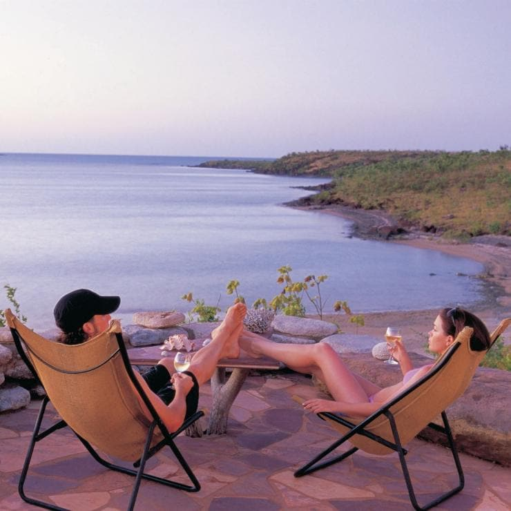 Couple relaxing at sunset at Faraway Bay on the north east Kimberley coast © Tourism Western Australia