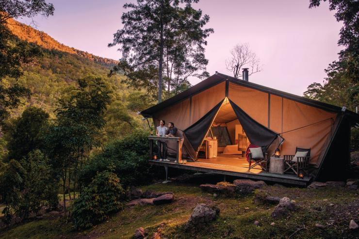 Couple at Nightfall Wilderness Camp in Lamington National Park © Tourism & Events Queensland