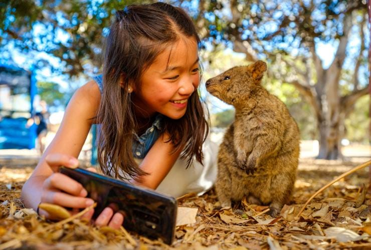 Girl taking selfie with Quokka on Rottnest Island in Western Australia © Tourism Australia/Dan Avila Photography