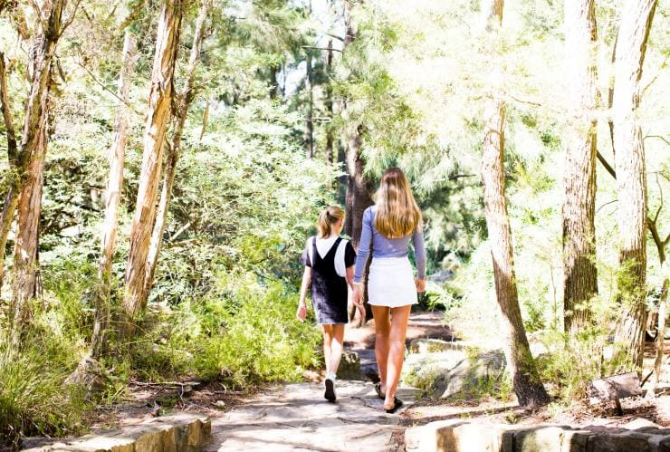 Two girls walking through Australian National Botanic Gardens © VisitCanberra
