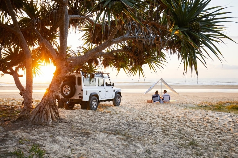 Couple on beach, Fraser Island, Queensland © Tourism & Events Queensland