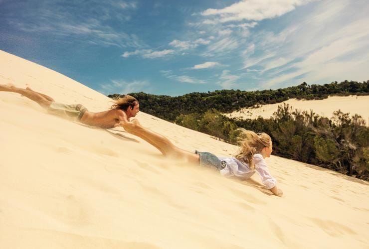 Sand tobogganing, Moreton Island, QLD © Tourism and Events Queensland