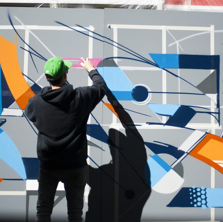 Vans the Omega graffiti artist at work in the Canberra Museum and Gallery courtyard, Canberra, Australian Capital Territory © Martin Ollman, VisitCanberra