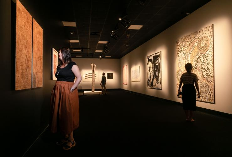 Visitors viewing Aboriginal artwork at the Museum and Art Gallery of the Northern Territory © Courtesy of MAGNT/Charlie Bliss