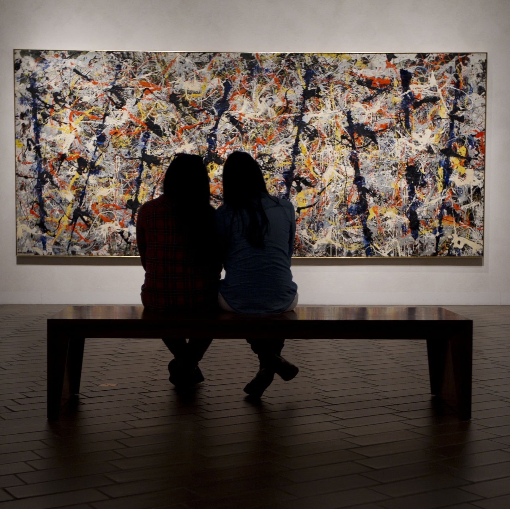 Visitors admire Blue Poles painting at the National Gallery of Australia © VisitCanberra
