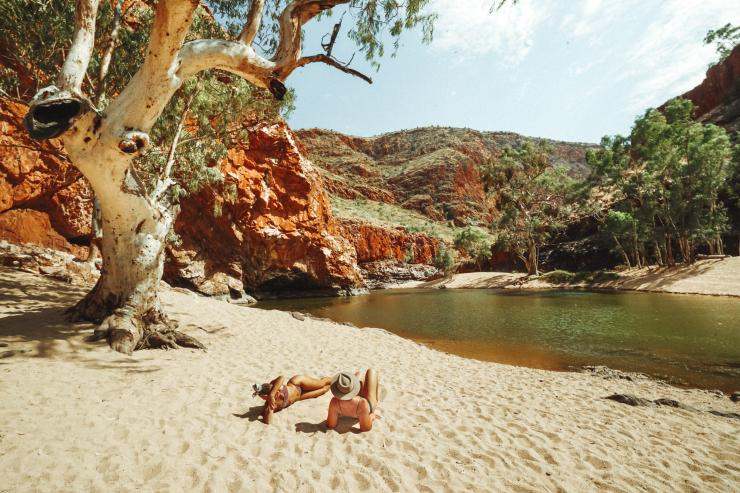 Friends relaxing at Ormiston, West MacDonnell, Northern Territory © Tourism NT/Jordan Hammond