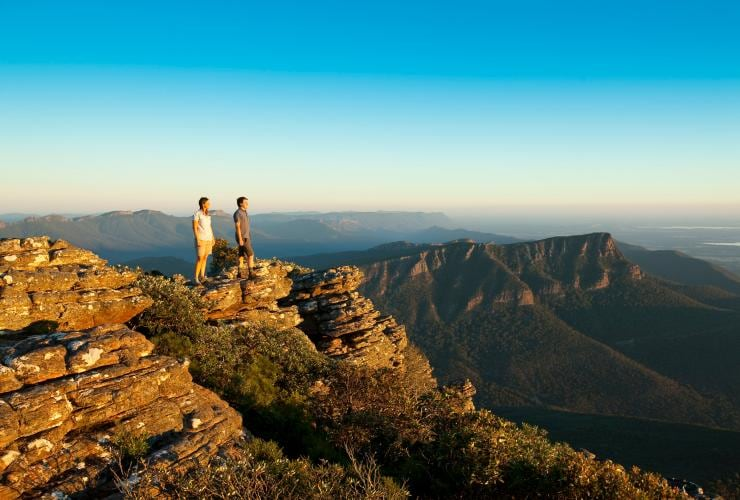 Couple stands on Mt William enjoying a view of the Grampians in Victoria ©  Robert Blackburn