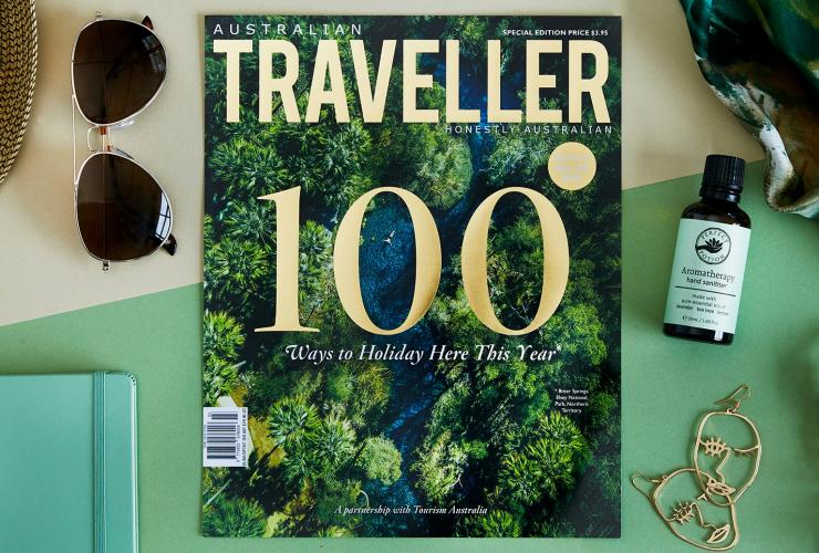 Aerial image of a magazine on a table with travel items © Australian Traveller