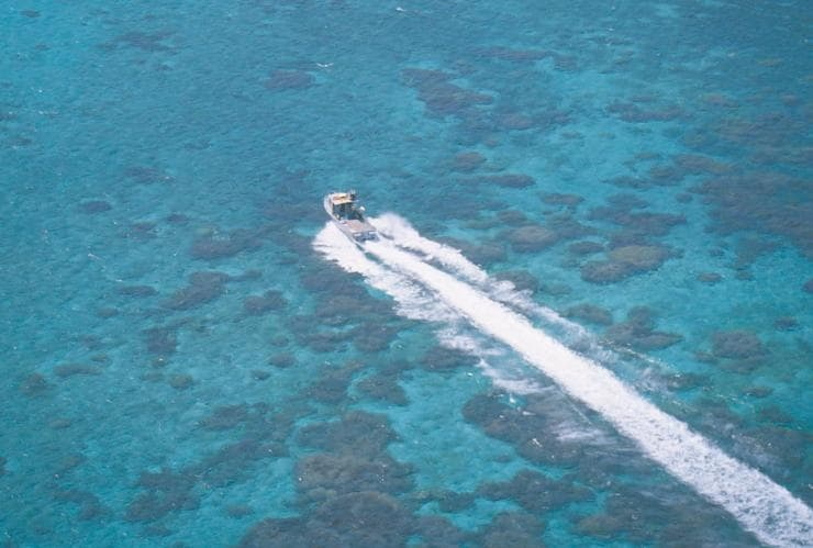 Aerial view of a cray fishing boat speeding through blue ocean water in the Abrolhos Islands © Tourism Western Australia