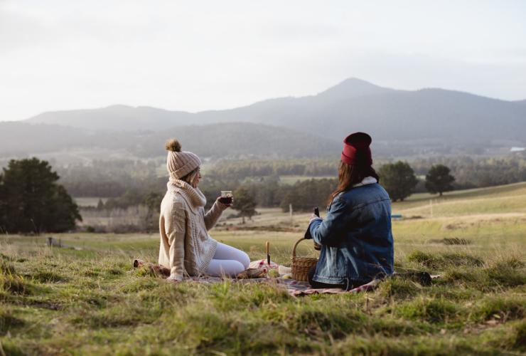 Two young woman enjoying a picnic in the Huon Valley © Samuel Shelley