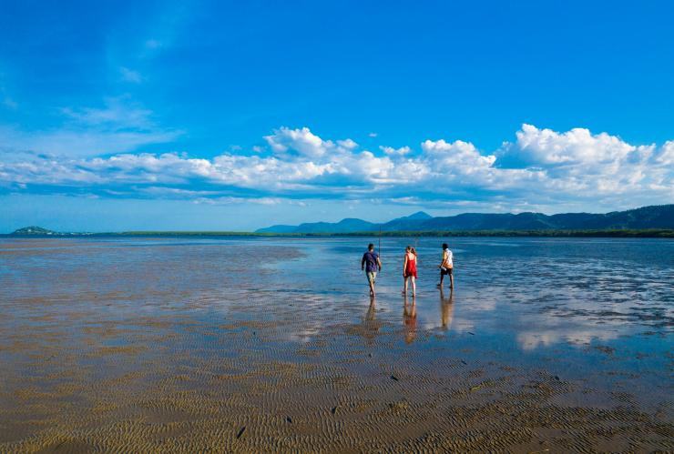 People walking on the beach at Port Douglas © Tourism and Events Queensland