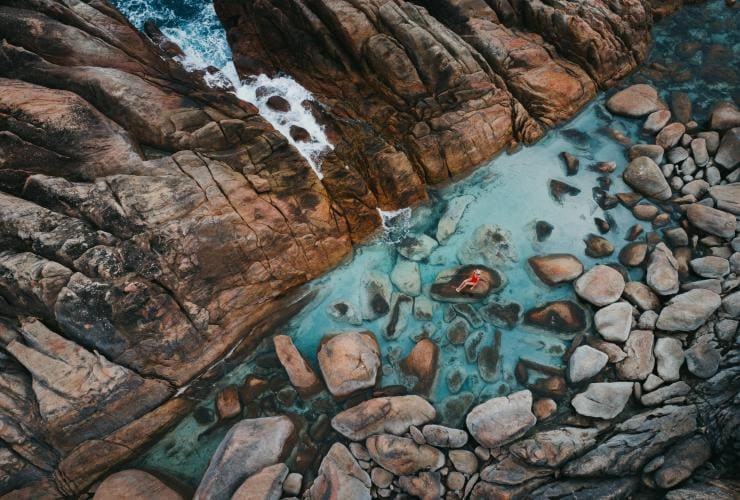 Aerial view of a woman sitting on a rock in Injidup Natural Spa © Jarrad Seng / Tourism Western Australia