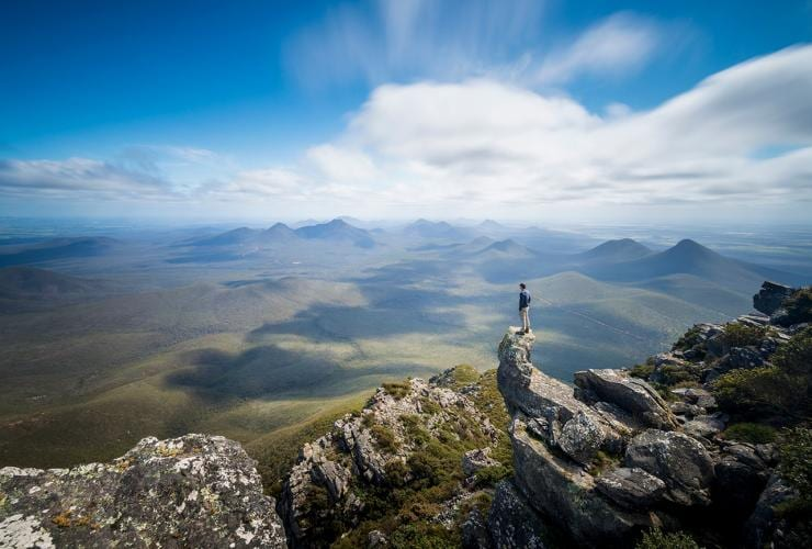 Man looking at the view from Mt Toolbrunup Summit in Stirling National Park © Australia's South West Inc.