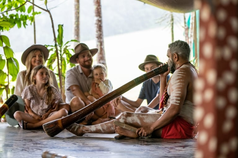 Family watching didgeridoo performance at Rainforestation Nature Park © Tourism and Events Queensland