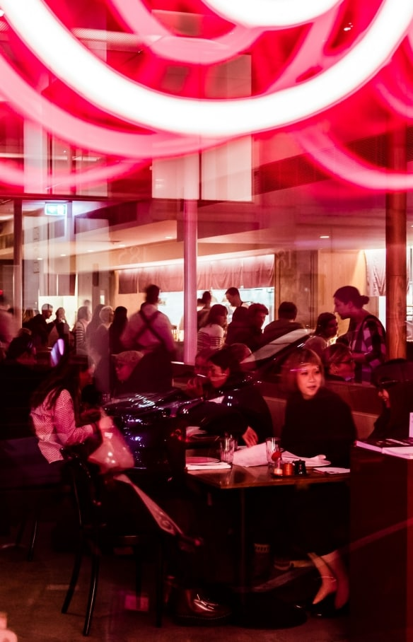 Bright neon lights and people fill out Supernormal, Melbourne © Trader House Restaurants, Nikki To