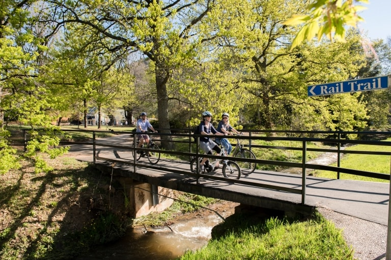 Cyclists crossing a bridge along the Murray to Mountains Rail Trail © Ride High Country