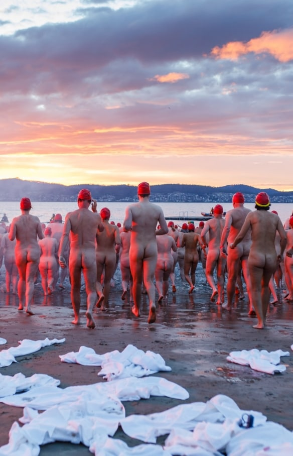 Swimmers on the beach for the Nude Solstice Swim in Hobart © Dark Mofo/Jesse Hunniford