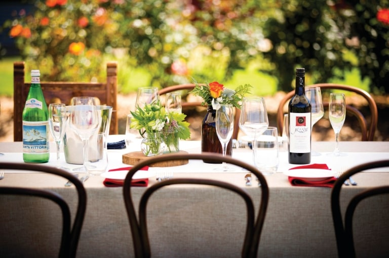Dining table set with wine at Pizzini Wines © Pizzini Wines