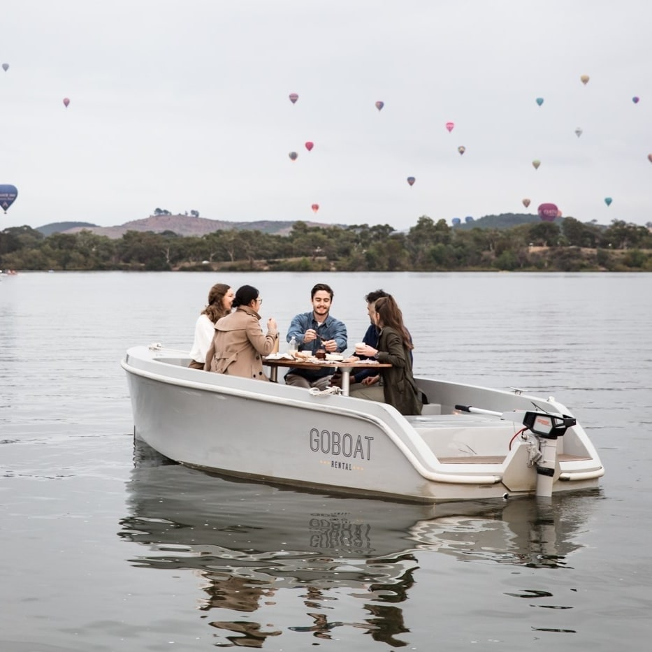 Group of friends in a Go Boat on Lake Burley Griffin in Canberra © Lean Timms