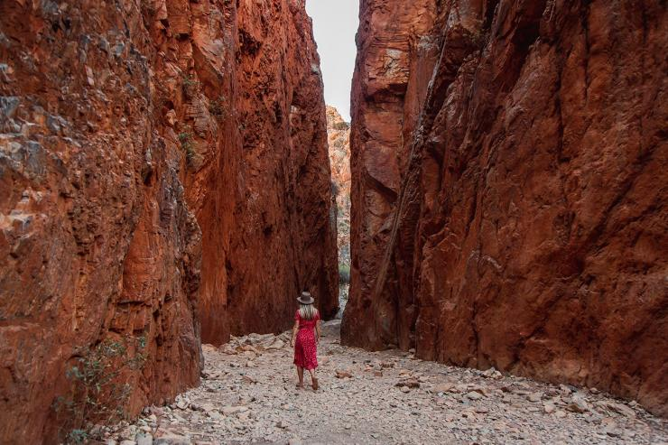 Woman walking through Standley Chasm, West MacDonnel Ranges, Northern Territory © Tourism Australia