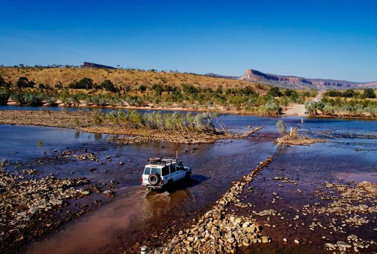 Aerial view of a 4WD travelling through a shallow river at the Pentecost River Crossing in Western Australia © Tourism Western Australia