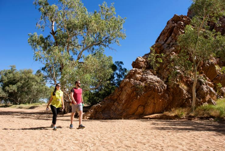 Couple walking through Yeperenye (Emily and Jesse Gaps) Nature Park © Tourism NT/Shaana McNaught