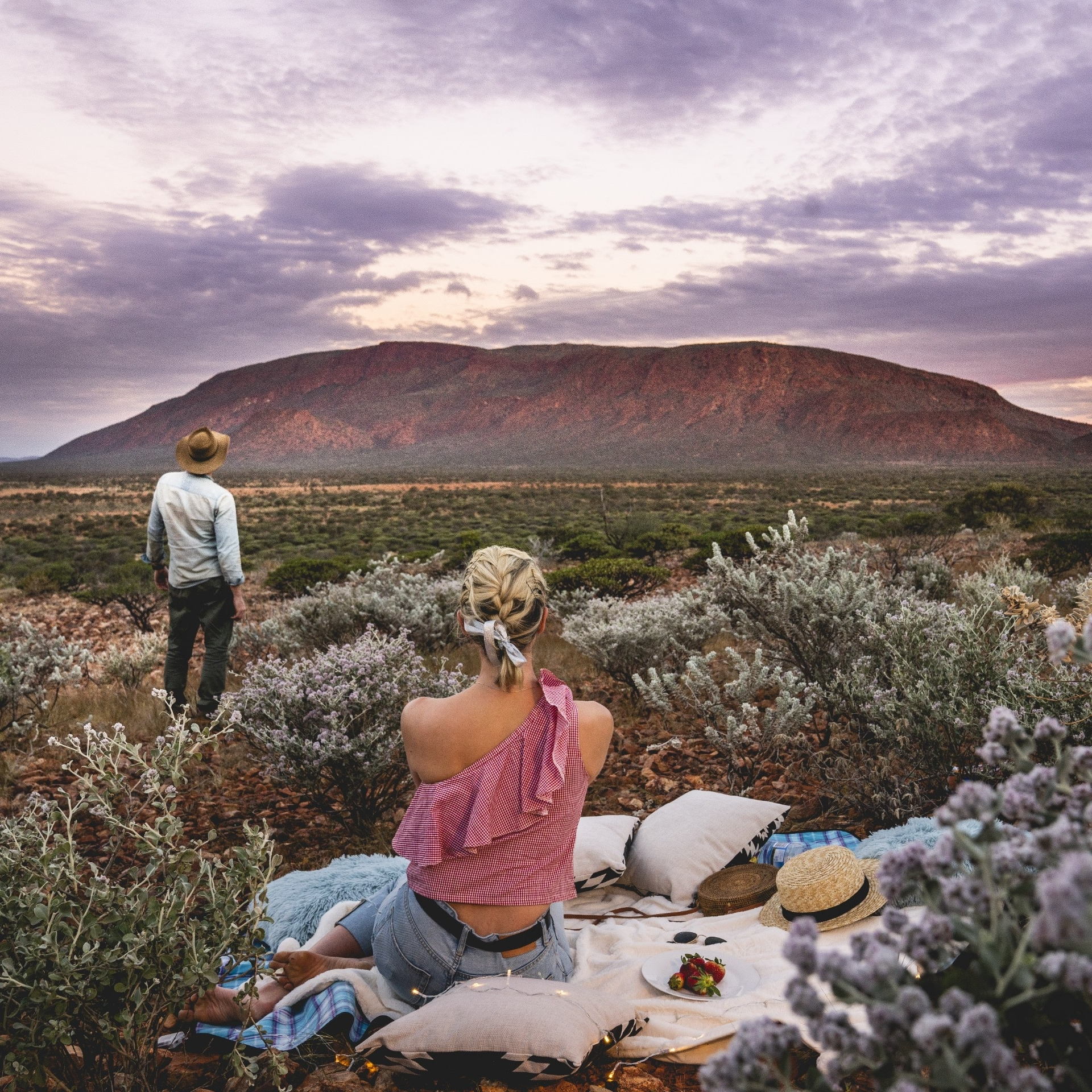 Couple enjoying a picnic with a view of Mount Augustus © Australia's Golden Outback