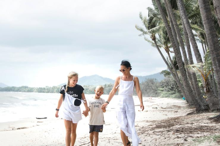 Family walking on the beach at Palm Cove © Tourism and Events Queensland