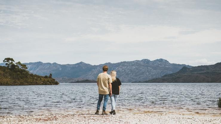 Couple at Lake Pedder, Southwest National Park, TAS © Tourism Tasmania