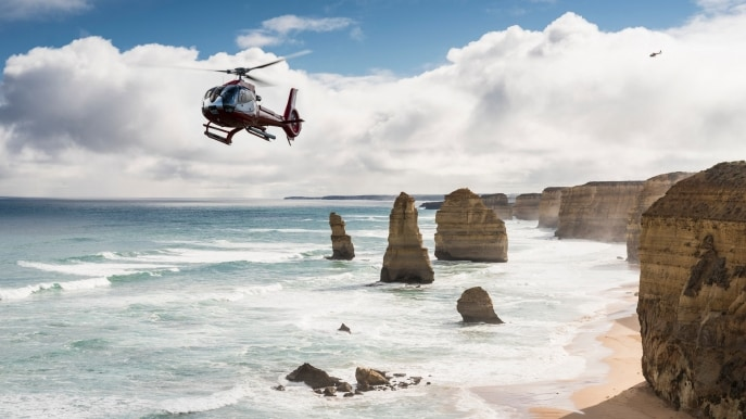 Helicopter over the 12 Apostles, Great Ocean Road, VIC © Visit Victoria