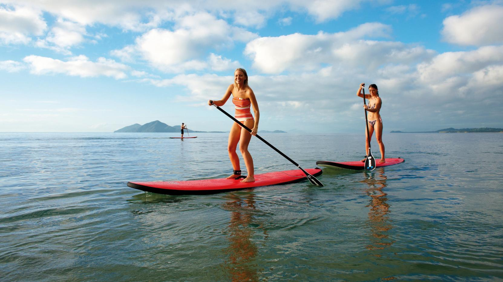 Stand up paddle boarding, Mission Beach, QLD © Tourism and Events Queensland
