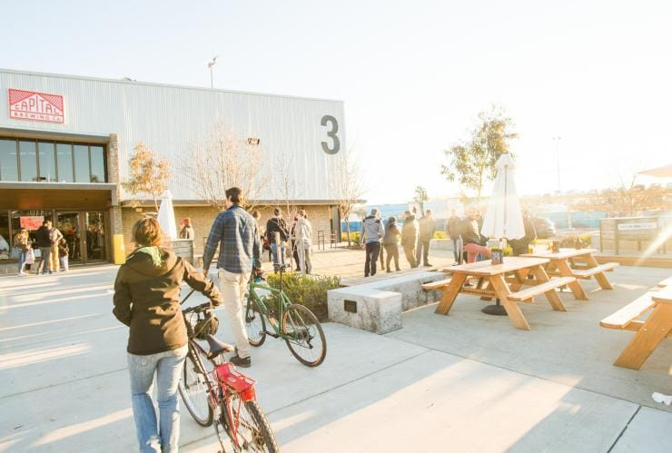 Cyclists arriving at Capital Brewing Co at the Dairy Road precinct in Fyshwick © VisitCanberra