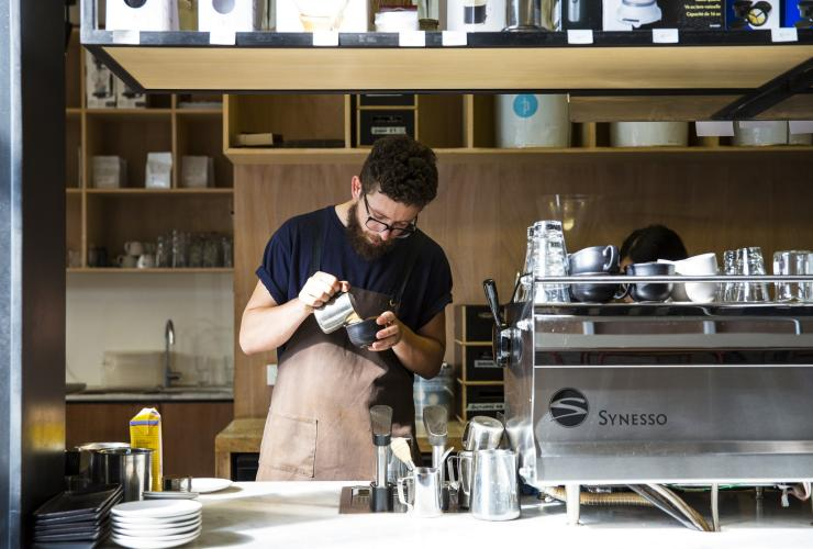 Barista pouring coffee at Industry Beans in Melbourne © Josie Withers Photography