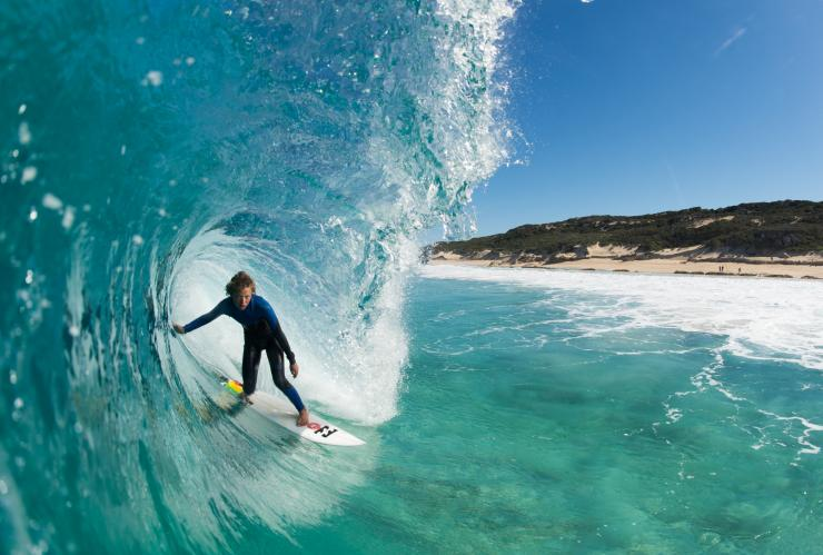 Surfing Margaret River's clear waves, WA © Tourism Western Australia