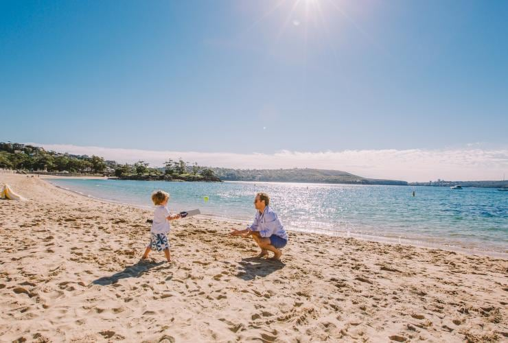 Father and son at Balmoral Beach in Sydney © Tourism Australia