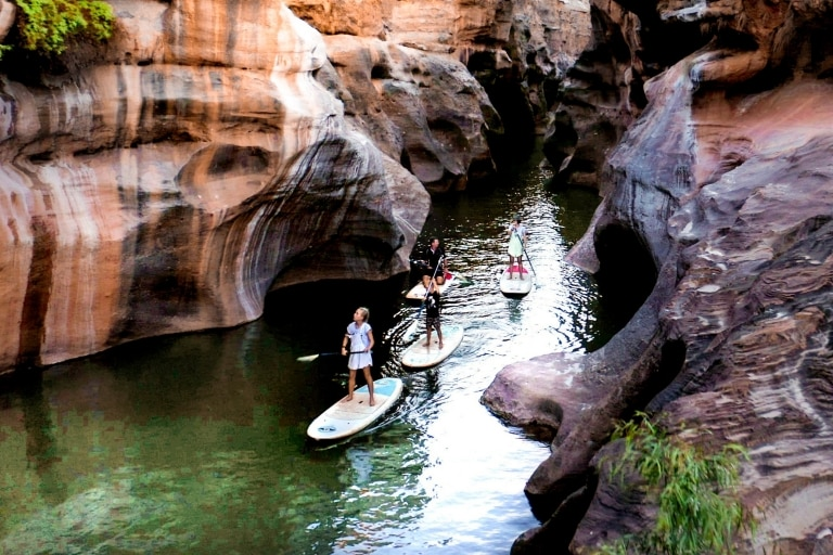 Family paddleboarding through Cobbold Gorge © Tourism and Events Queensland