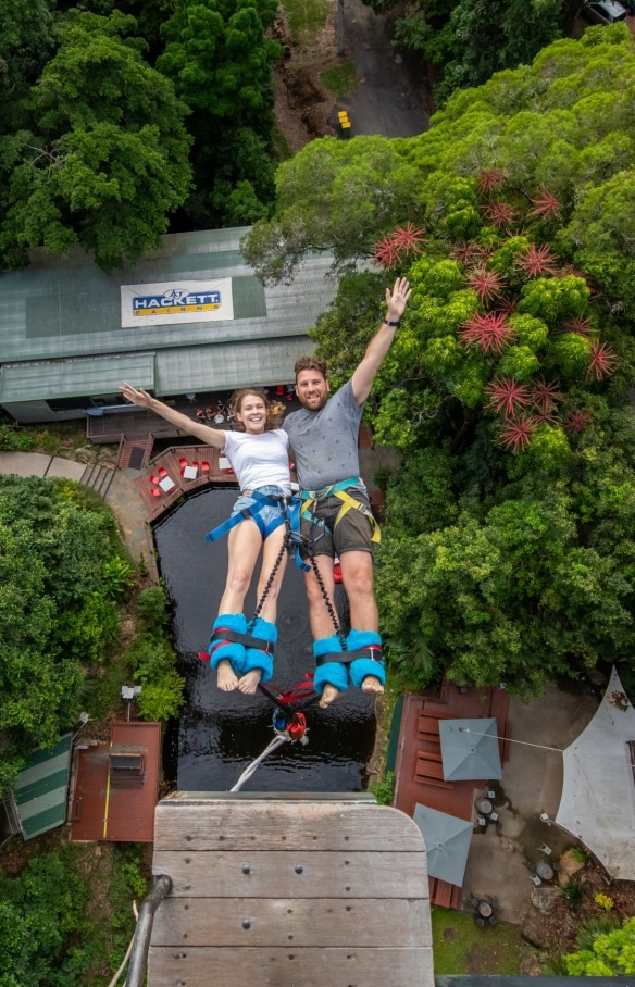 Bungee-jumpers mid-air at AJ Hackett Bungy Jumping in Cairns © Skypark Cairns by AJ Hackett