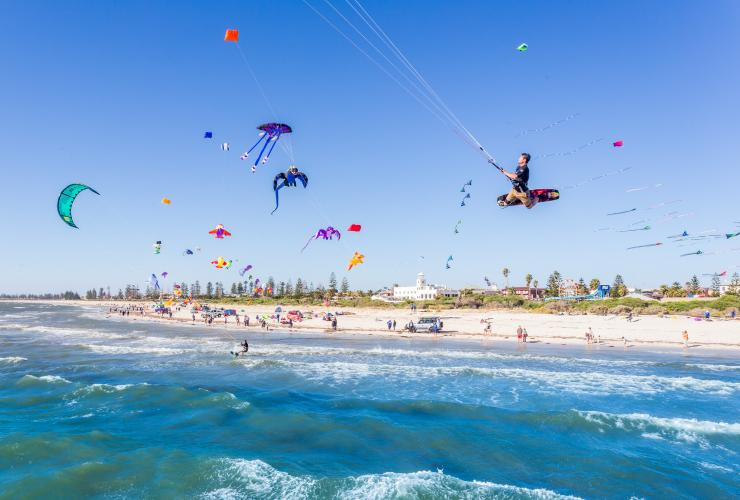 Colourful kites flying at Semaphore Beach in Adelaide © Michael Waterhouse Photography